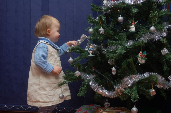 Helping to decorate the tree